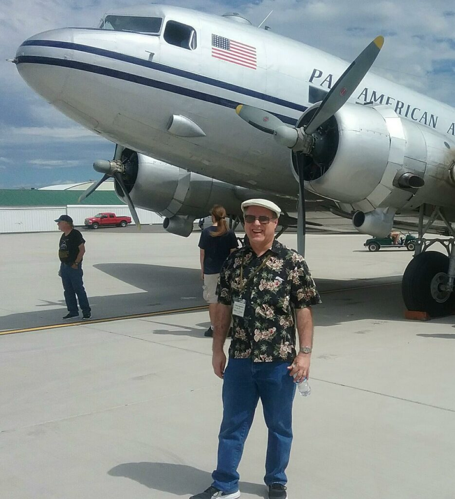 The author standing in front of a silver DC-3 at Felts Field, Spokane
